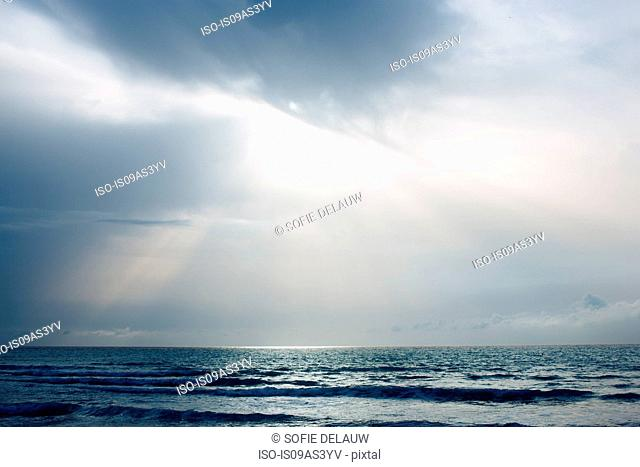 Seascape with sunbeams and storm clouds