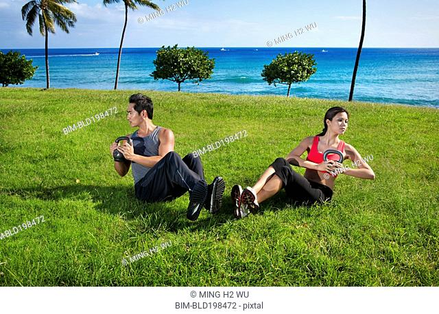 Couple exercising together at waterfront