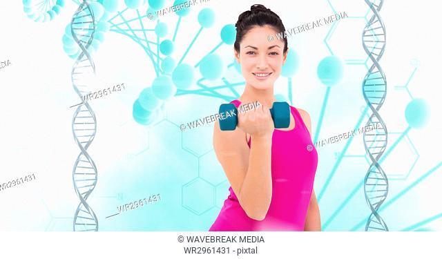 Healthy woman lifting dumbbell against DNA structure