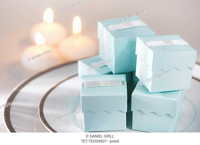 Pastel composition with gifts packages and candles