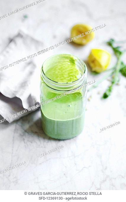 Creamy pesto dressing in a glass