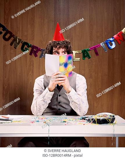 Businessman reading birthday card