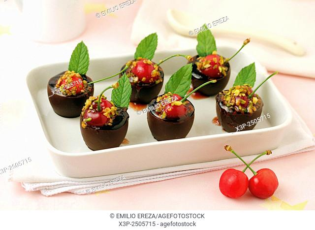 Chocolate little cups with cherries