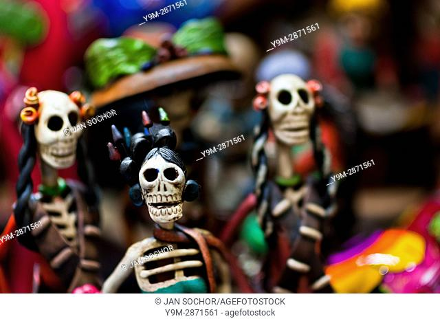 Calaca figurines are sold on the market during the Day of the Dead festivities in Mexico City, Mexico, 28 October 2016. Skulls