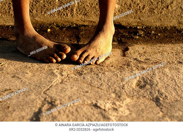Barefoot boy on the streets Granada, Nicaragua