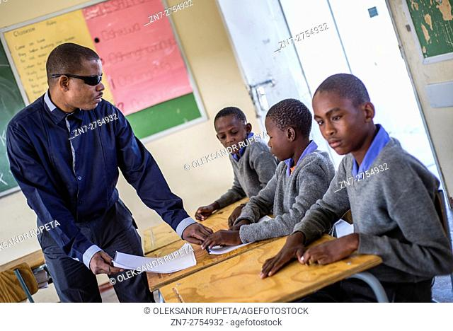 The teacher Tobias Mwaudikange has a lesson of natural science with the 4th grade of visually impaired children at Eluwa Special School in Ongwediva, Namibia