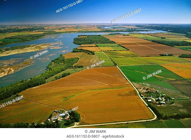Agriculture - Aerial view of agricultural fields along the Missouri River in Autumn, Nebraska on right, South Dakota on left / nr. Yankton, SD