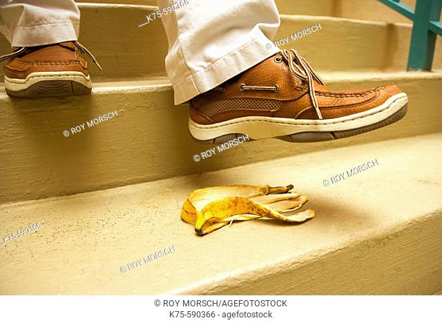 Man about to step on banana peel