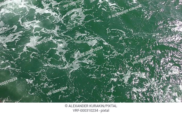 Foam on the sea surface in a wake