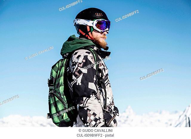 Portrait of skier, looking away