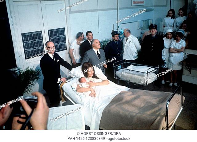 The parents, actress Sophia Loren and husband Carlo Ponti (in grey suit), proudly present their son Carlo Jr., born on 29 December 1968