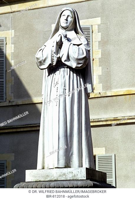 Statue of St. Bernadette of Lourdes in the St. Gildard monastery garden, Nevers, Nievre Department, France, Europe