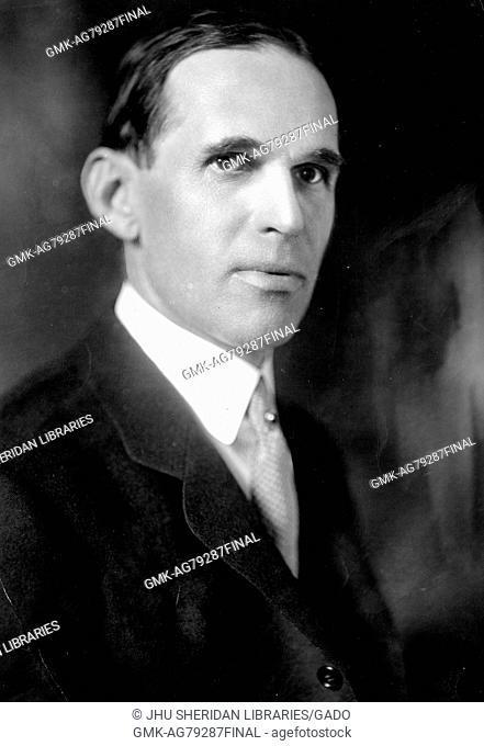 Portrait, shoulders up, of Walter Wheeler Cook, visiting professor of jurisprudence at Johns Hopkins University, slightly turned with stern face, Baltimore