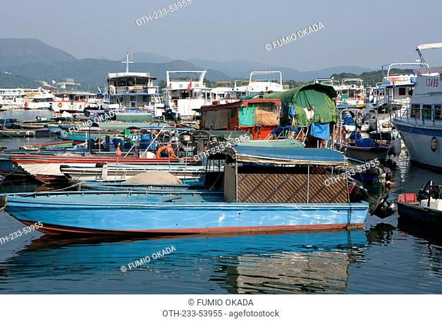 Fishing boats and yachts anchoring by the pier, Sai Kung, Hong Kong