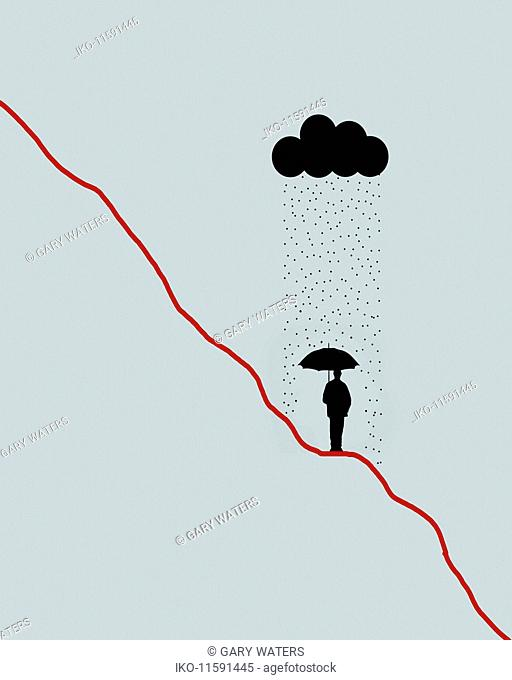 Businessman sheltering from rain on descending line graph