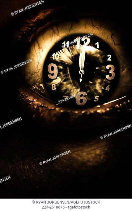 Dark dramatic horror portrait of a human eye open wide with reincarnation clock face. Past lives