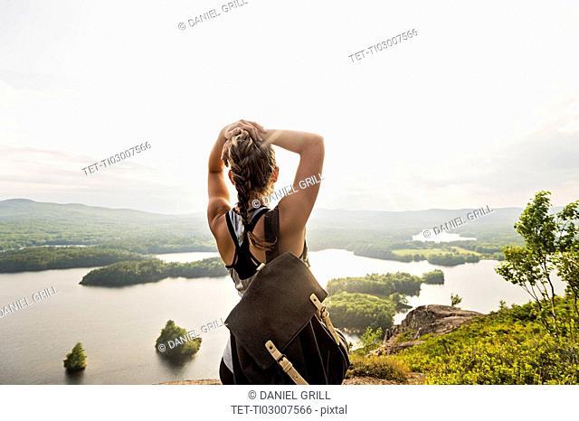 Rear view of young woman looking at lake