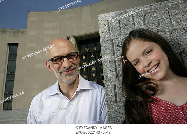 mature man and girl against memorial