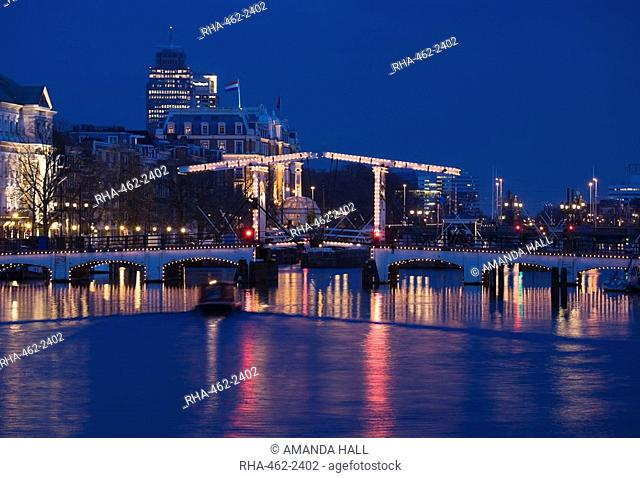 The Magere Bridge at night, also known as the Skinny Bridge, Amstel River, Amsterdam, Netherlands, Europe