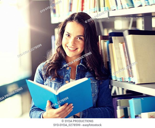 high school student girl reading book at library