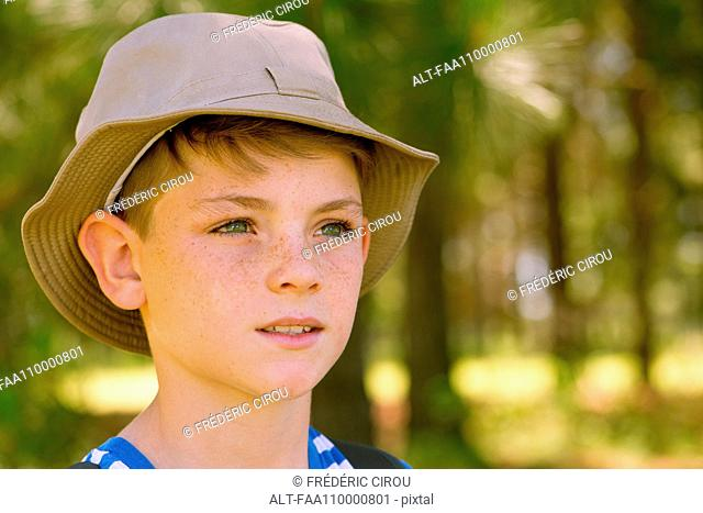 Preteen boy looking into distance
