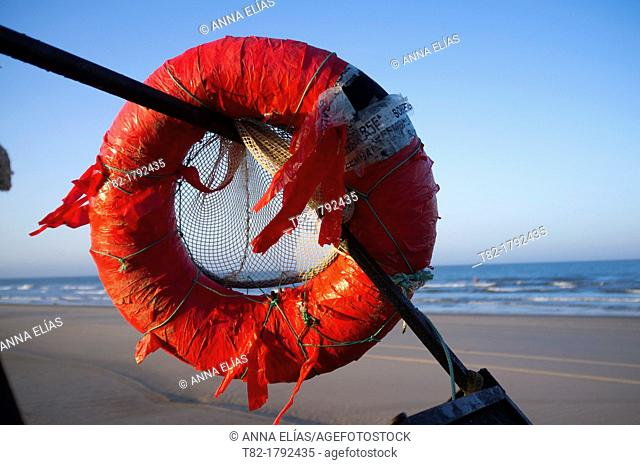 Old red float fisherman on the beach at Doñana Natural park, Huelva, Andalusia, Spain, Europe