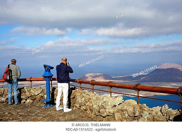Mirador del Rio, cliff-top viewpoint designed by Cesar Manrique, telescope and balustrade, view over strait El Rio to Island La Graciosa, Chinijo Archipelago