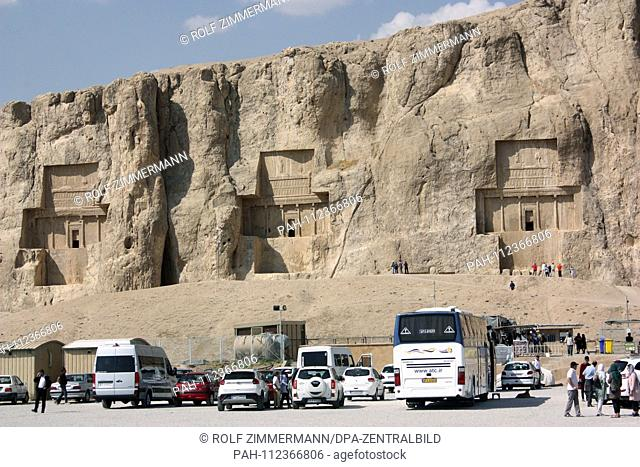 Iran - Naqsh-e Rostam with the cross-shaped rock graves of the King (from left to right) Darius II, Artaxerxes I, Darius I, Fars Province, north of Persepolis