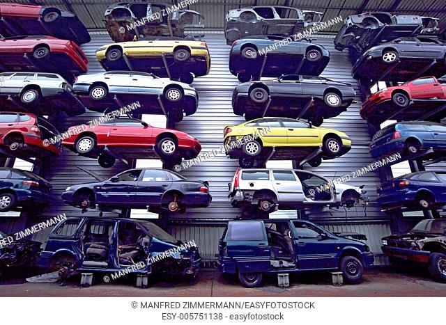 Disused cars on junkyard, neatly stacked