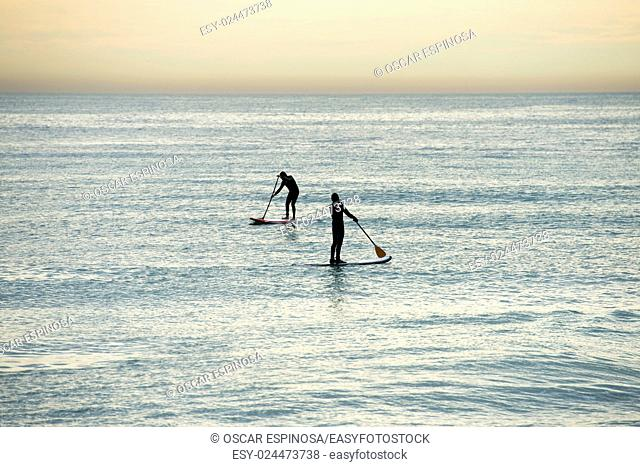 Paddle surf on the beach