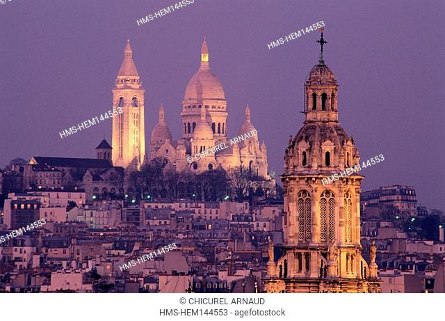 France, Paris, Sacre Coeur Basilica and the bell tower of the Trinity church on the right