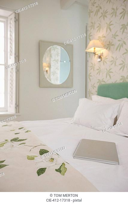 Laptop on luxury bed