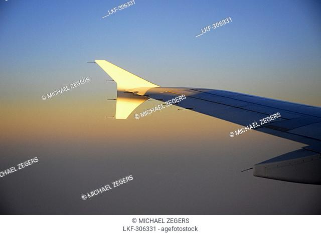 Airplane wing in sunset light, approach to Malta, Europe