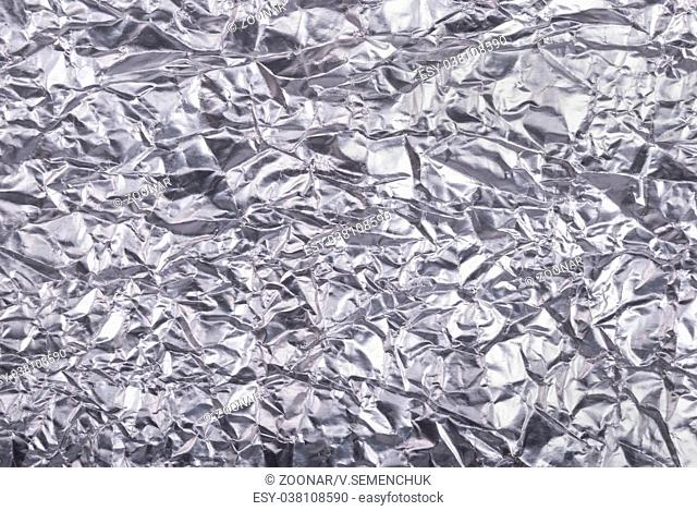Silver crumpled foil texture background