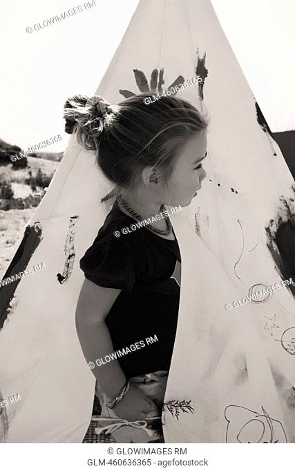 Baby girl looking out of a tent, Santa Fe, New Mexico, USA