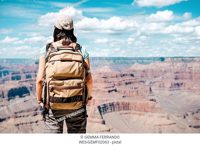 USA, Arizona, Grand Canyon National Park, Young woman with backpack exploring and enjoying the landscape
