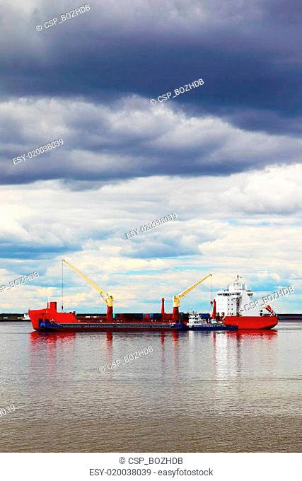 cargo ship sailing on the river
