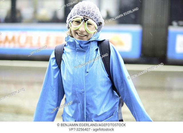woman with funny eyeglasses standing in winter at street, in Munich, Germany