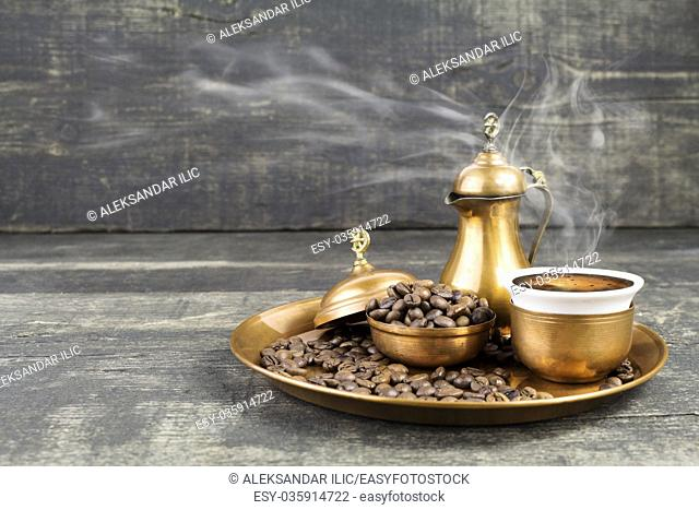 Turkish coffee with traditional copper serving set and coffee beans