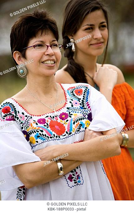 Mexican mother and daughter standing together