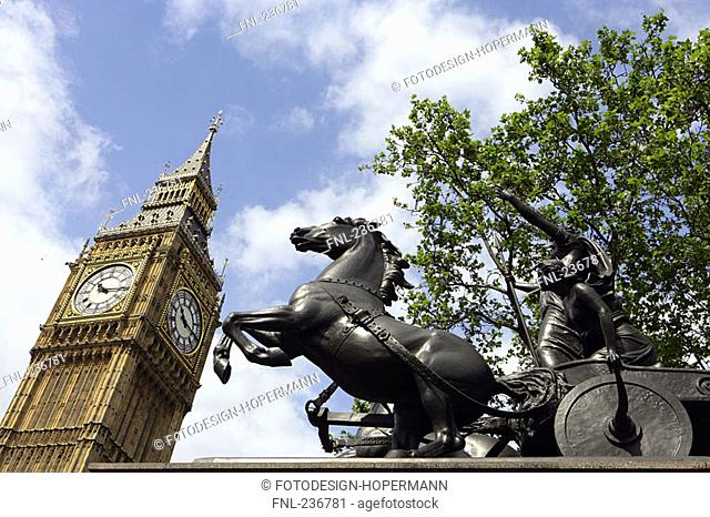 Low angle view of clock tower and Chariot statue, Big Ben, City of Westminster, London, England
