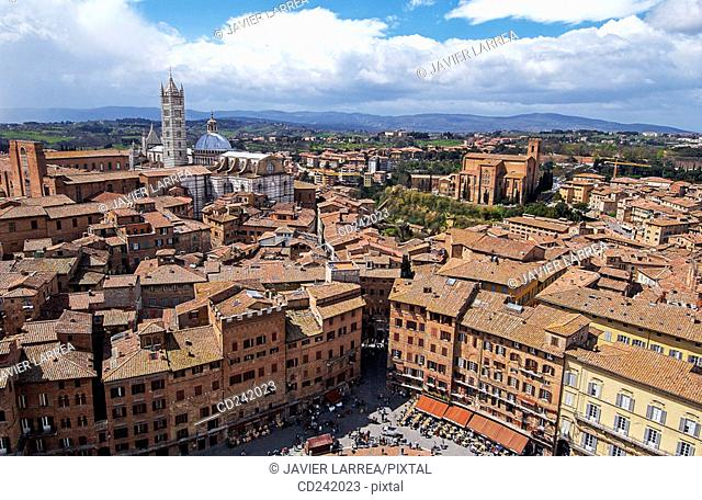 Piazza del Campo with duomo on the left and church of San Domenico on the right. Siena. Tuscany, Italy
