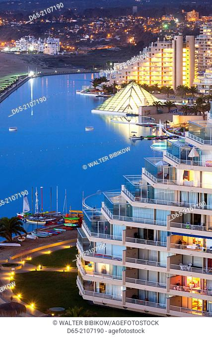 Chile, Algarrobo, San Alfonso del Mar, World's largest man-made pool, elevated view, dusk
