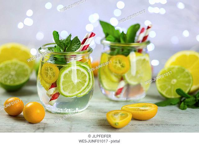 Infused water with lime, lemon, kumquat and mint