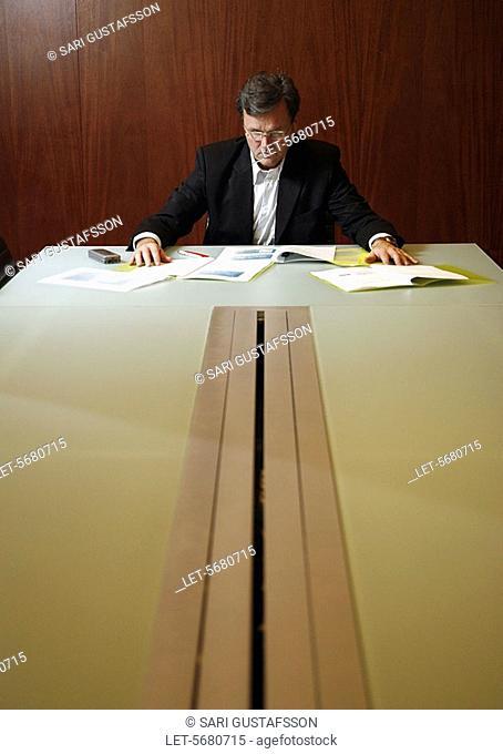Man at negotiation table