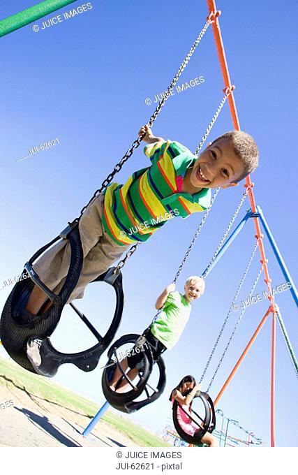Children on swing set at playground