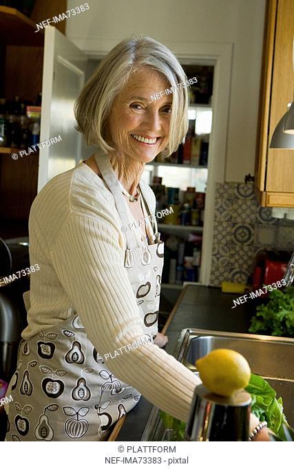 Senior woman in a kitchen, Sweden
