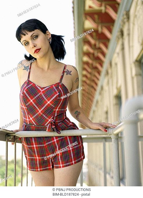Woman wearing retro dress on balcony