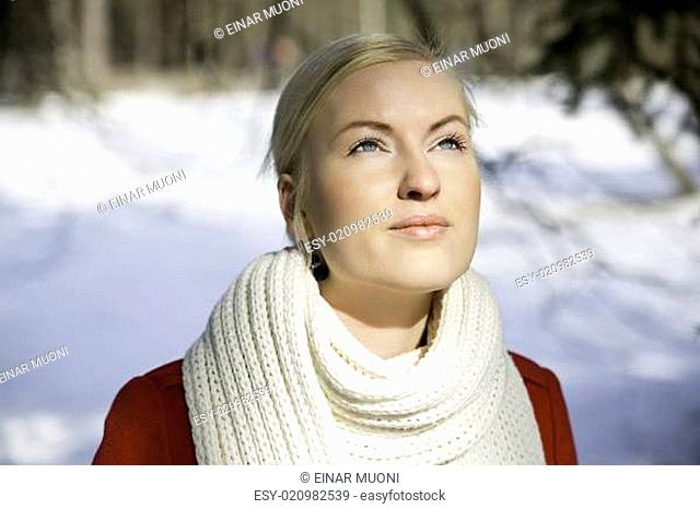 Zoomed woman warming face under sunlight
