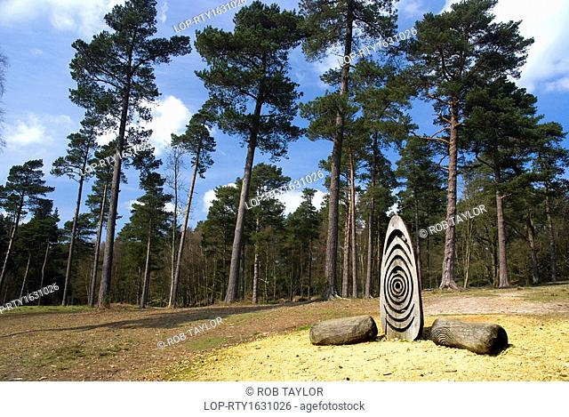 England, Surrey, Leith Hill. 'Oak Stones', a wood sculpture by Walter Bailey on Leith Hill, the highest point in South-east England